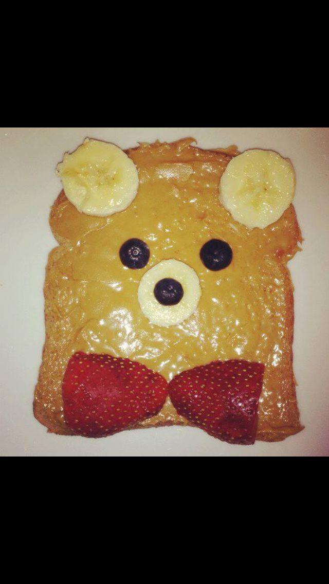 Toast. Sliced blueberries. Sliced bananas. Sliced strawberries. On PB n honey spread.