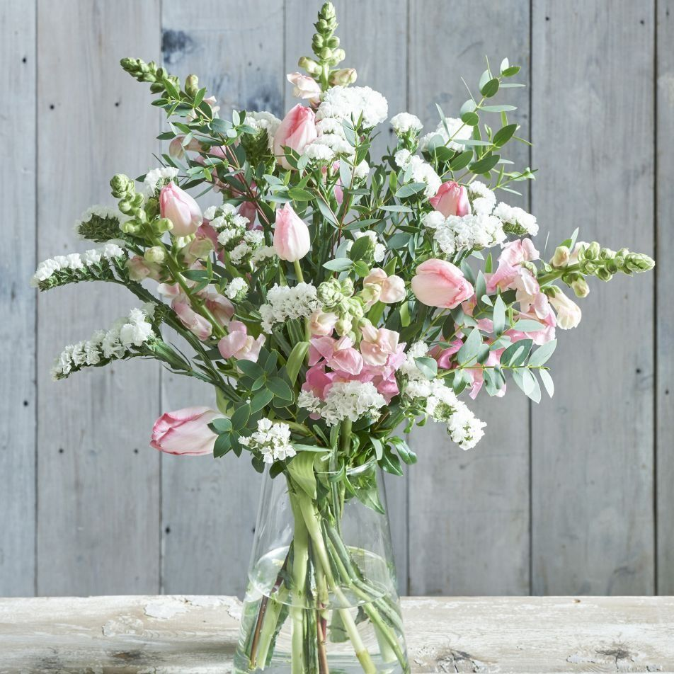 Blooming With Tulips Antirrhinums Eucalyptus And Statice This