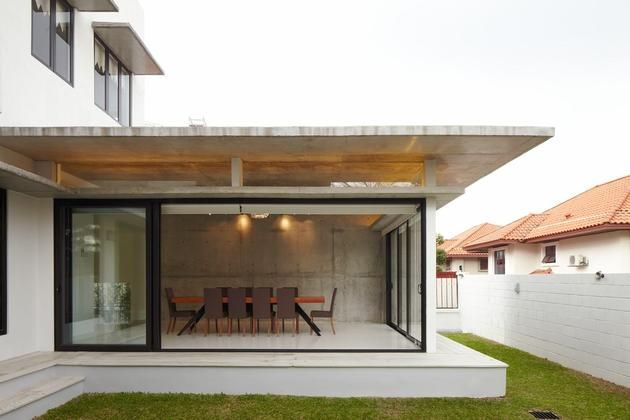 curved-stacking-glass-doors-surround-drum-shaped-room-voila-house-11- dining.jpg