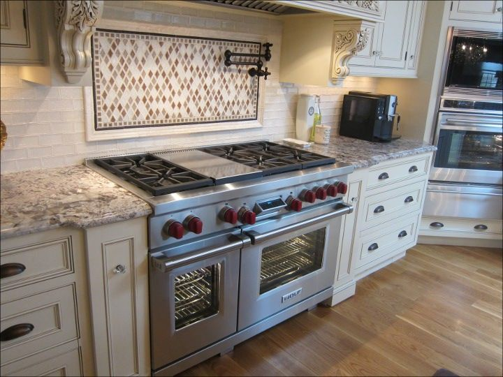 wolf kitchen ranges oak cabinet this is my range just not dual fuel 48 6 burner with griddle i am really liking those cabinets it
