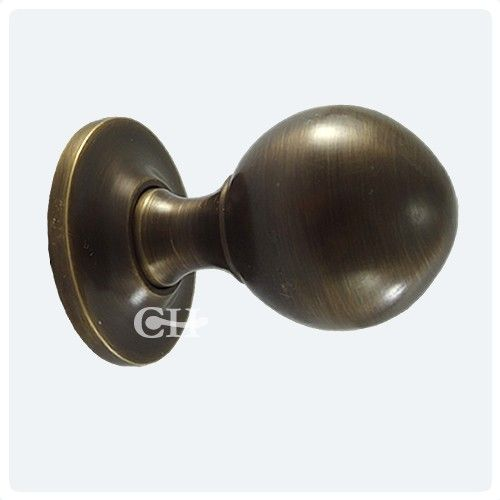 Antique brass door knobs on plain rose available in many finishes