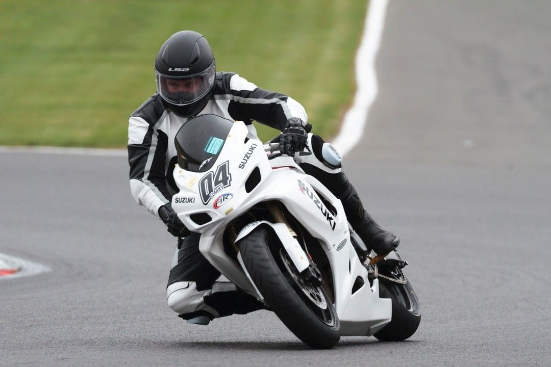 Man Riding White And Black Suzuki Sportbike Hd Wallpaper