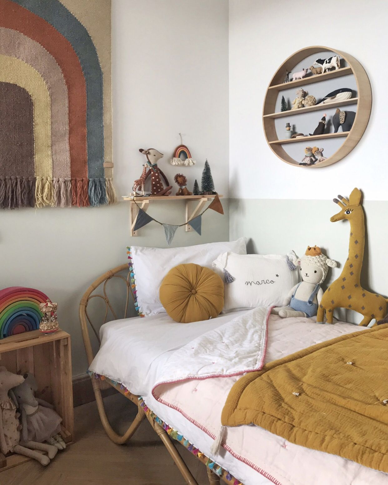 Photo of Kids room in mustard and green with #rattan bed and #rainbow touches