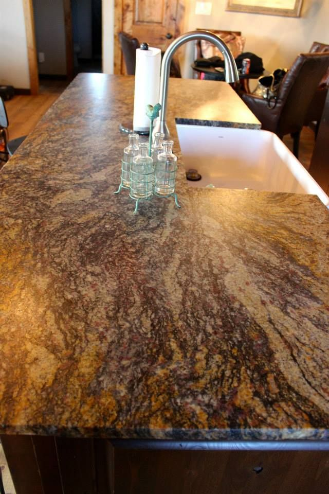 blue fire leathered granite with a chiseled edge kitchen island