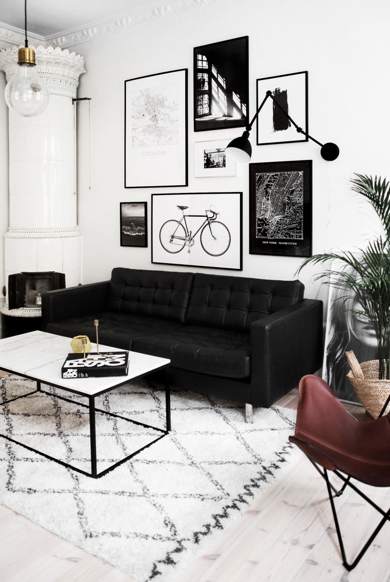 Black and white graphic art over a couch