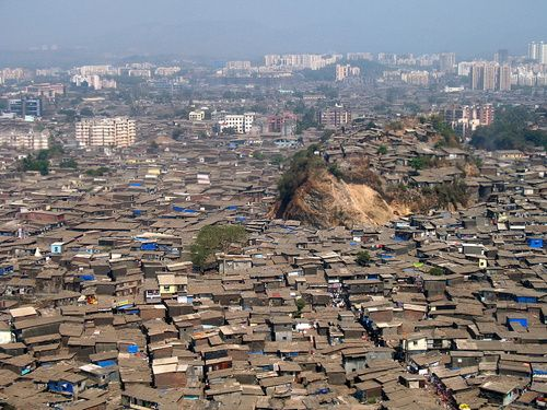 An aerial view of the slums of Mumbai, in the state of Maharashtra, India. Due to the lack of electricity in the slums, families have found ways to bring light to their homes by filling plastic bottles with water - and bleach for sanitation - and suspending the bottles from slits in the roofs.