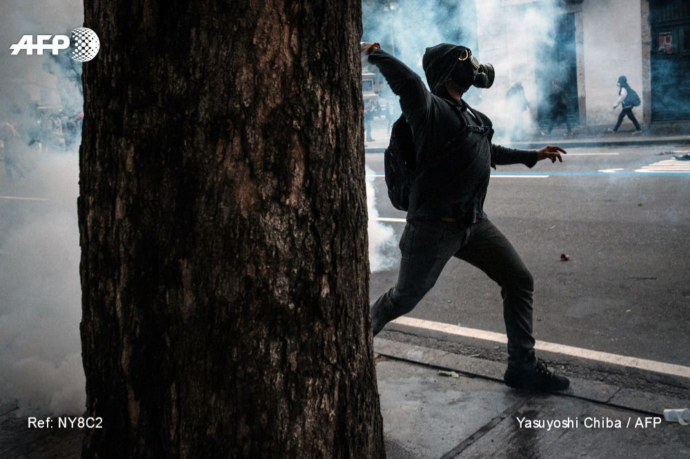 A Protester Throws Back A Tear Gas Canister Against Military