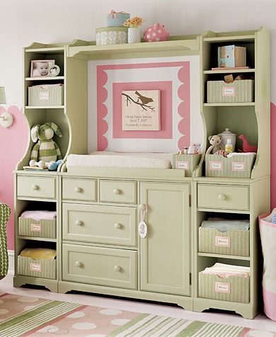 Re-purposed entertainment center is now a hutch for nursery with changing table and lots of space for storage for baby items.