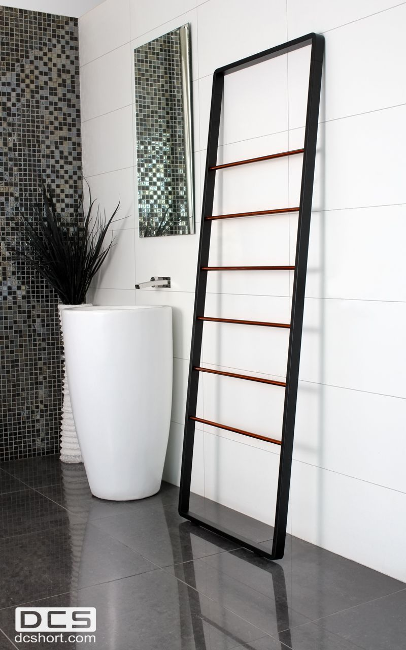Stainless steel heated ladder rail, with radiused corners. Matte black finish and horizontal tubing in copper finish.    H 1800mm X W 632mm www.dcshort.com