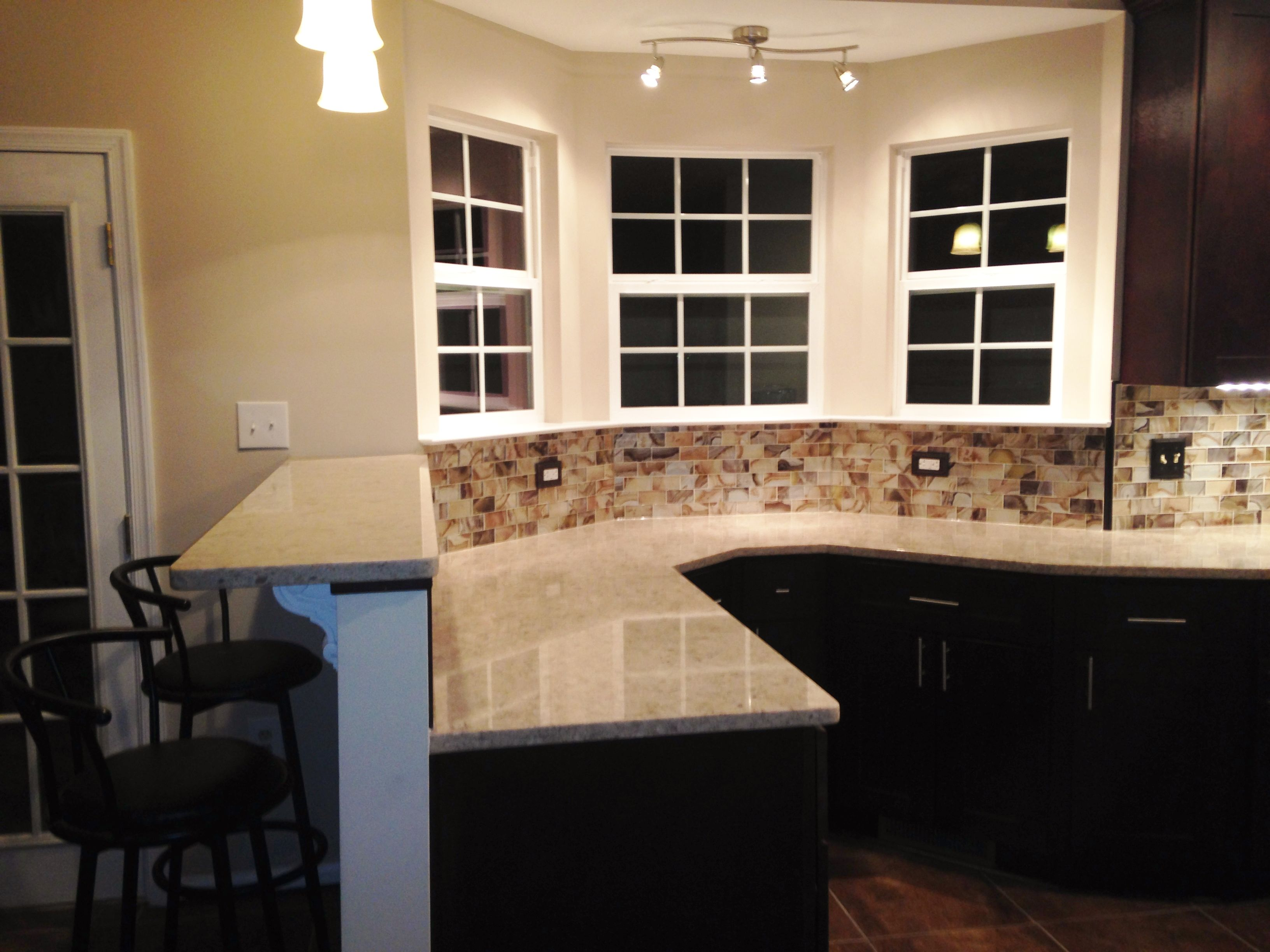 backsplash lighting. kitchen remodel glass tile backsplash silestone countertop pendant lighting directional lights g