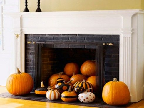 Autumn decoration of fireplace with pumpkins
