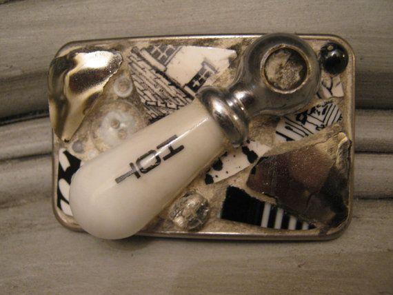 Mosaic belt buckle featuring vintage porcelain hot water faucet handle, mosaic art.