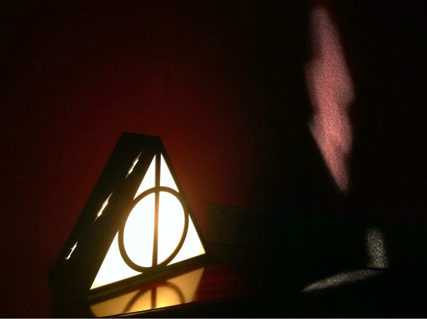 Harry Potter Deathly Hallows Lamp by Plasmatorium on Etsy https://www.etsy.com/listing/189738160/harry-potter-deathly-hallows-lamp
