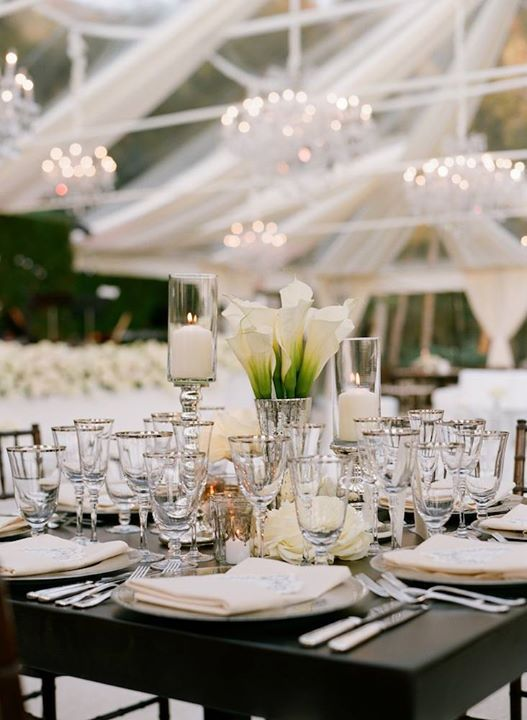 Wooden tables without tablecovers highlight the natural setting and arrangements of white calla lilies, orchids, roses, and hydrangea blossoms add elegance ~ https://www.insideweddings.com/weddings/georgetown-cupcake-cofounder-katherine-kallinis-california-wedding/405/