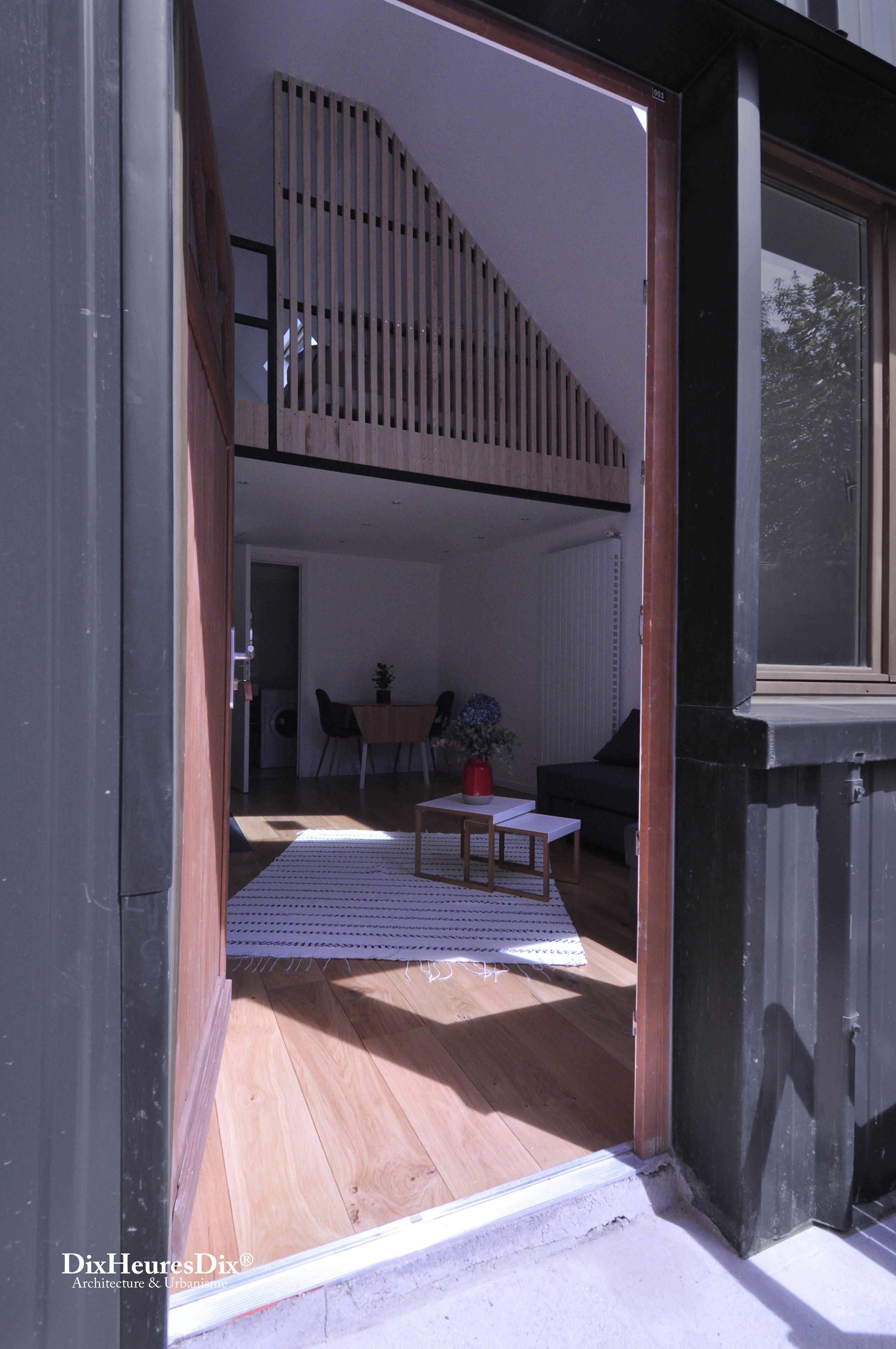 Réalisation entrée salon mezzanine bardage bois tapis