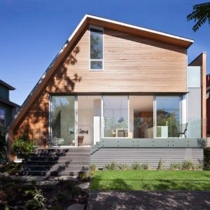 East Van House by Splyce Design  features an asymmetric sloping roof