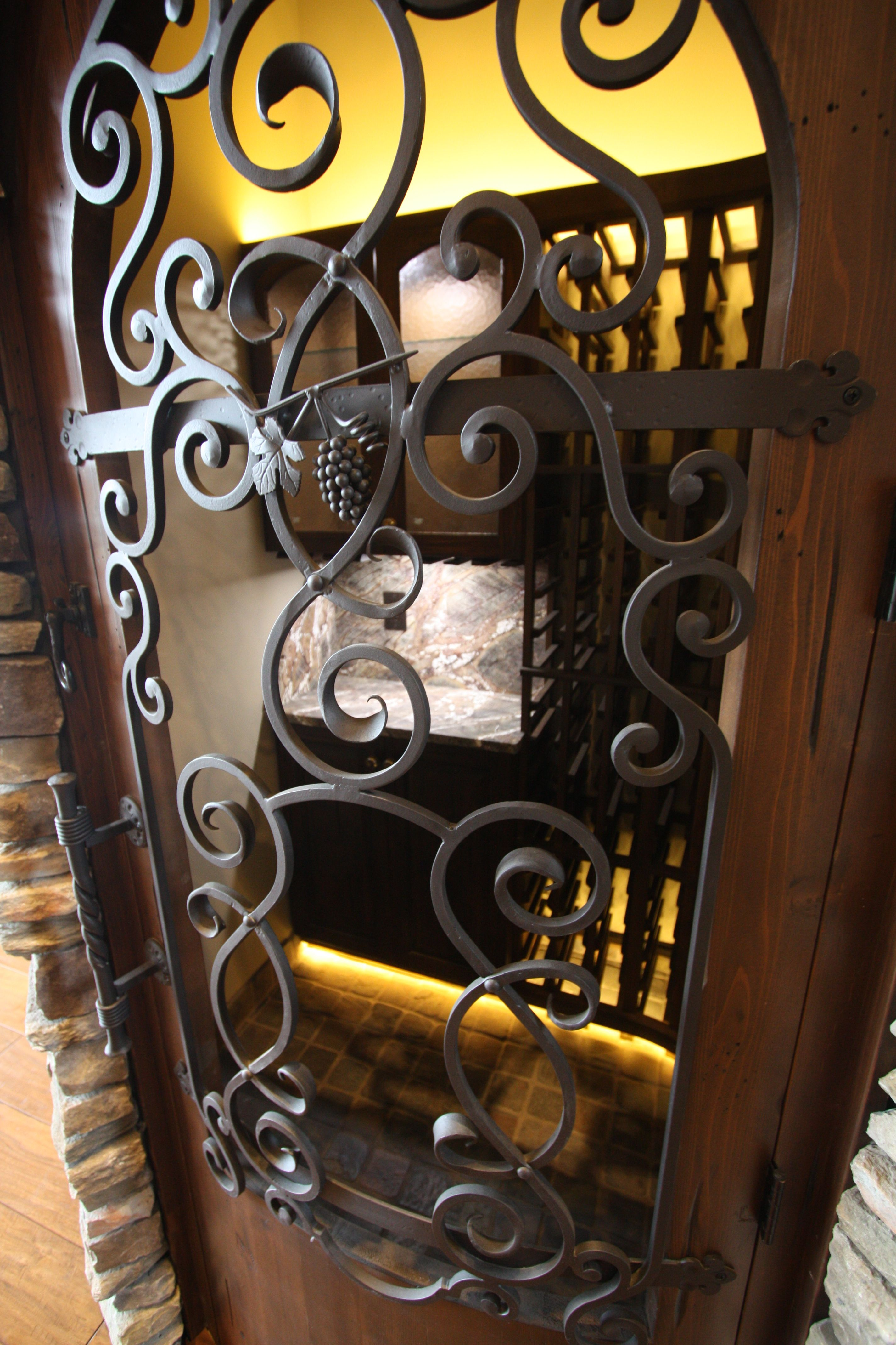 20 Glorious Contemporary Home Bar Designs You Ll Go Crazy For: Hand Forged Iron Scroll Work For A Wine Cellar Door