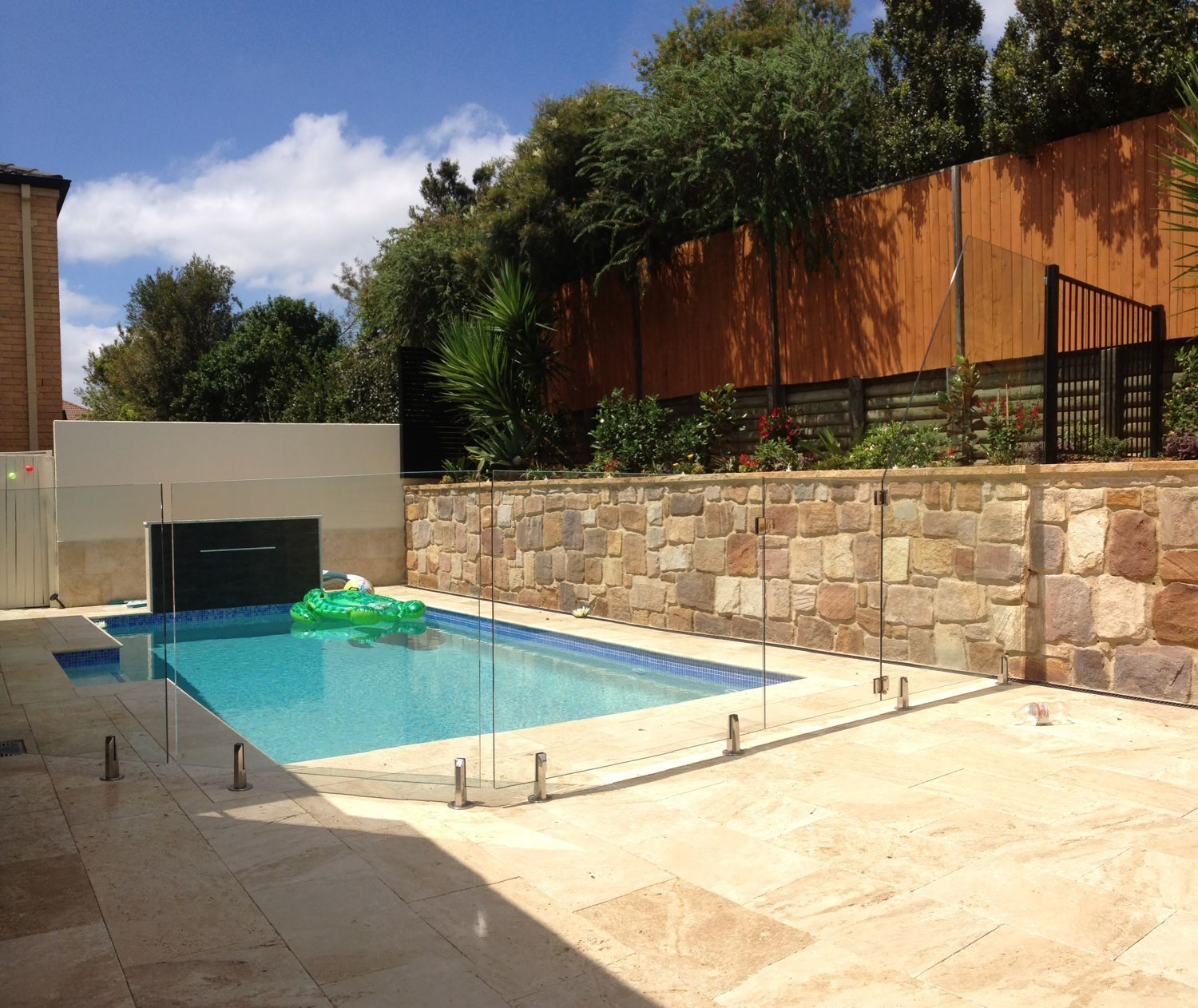 Pool fence over retaining wall google search swimming for Glass pool fences