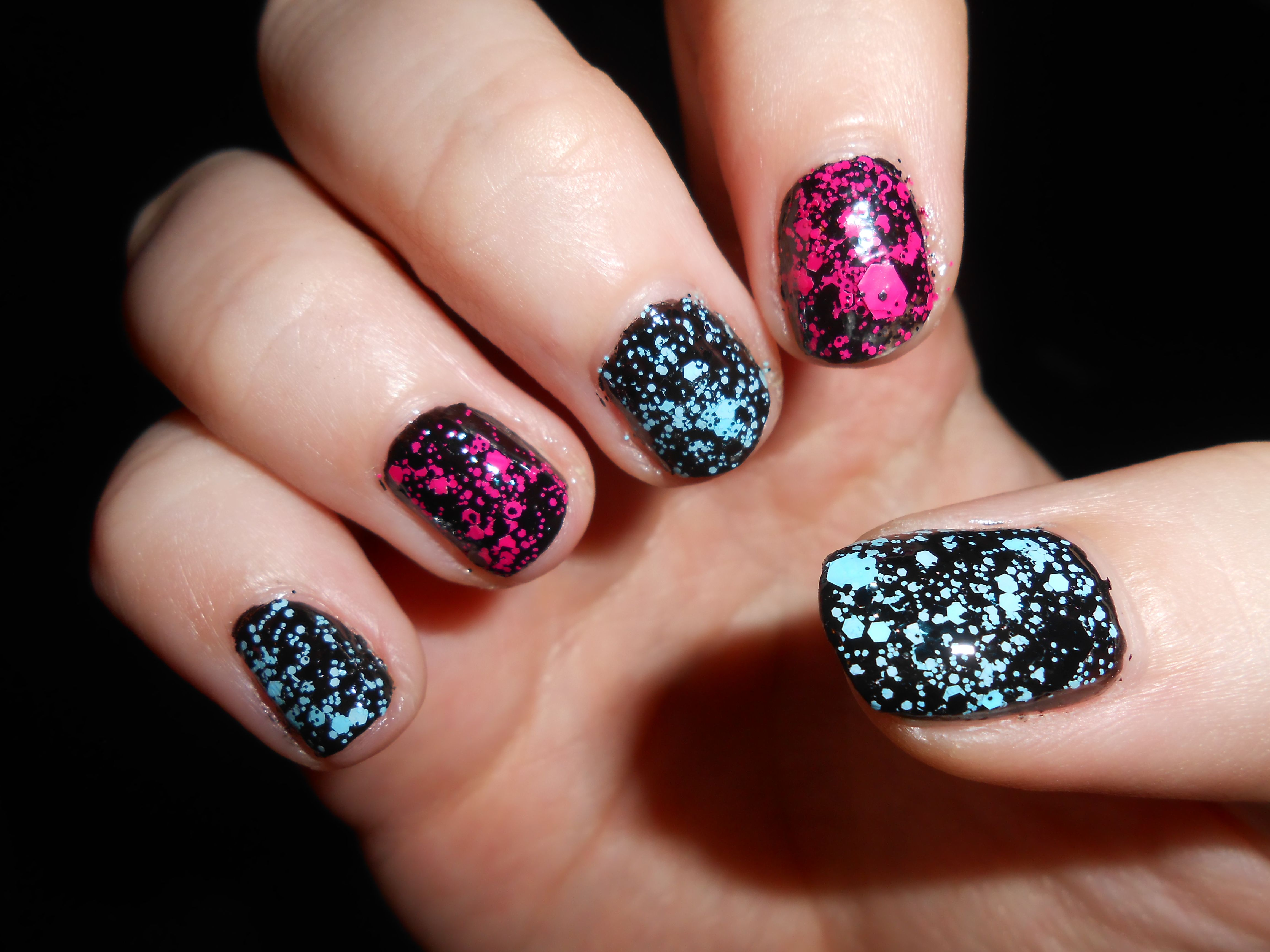 Paint splatter nails. Take a black nail polish and add either pink and black or or blue and black splatter nail polish. I got my nail polish at this page: http://www.torrid.com/product/splatter-skull-nail-polish/10446126.html
