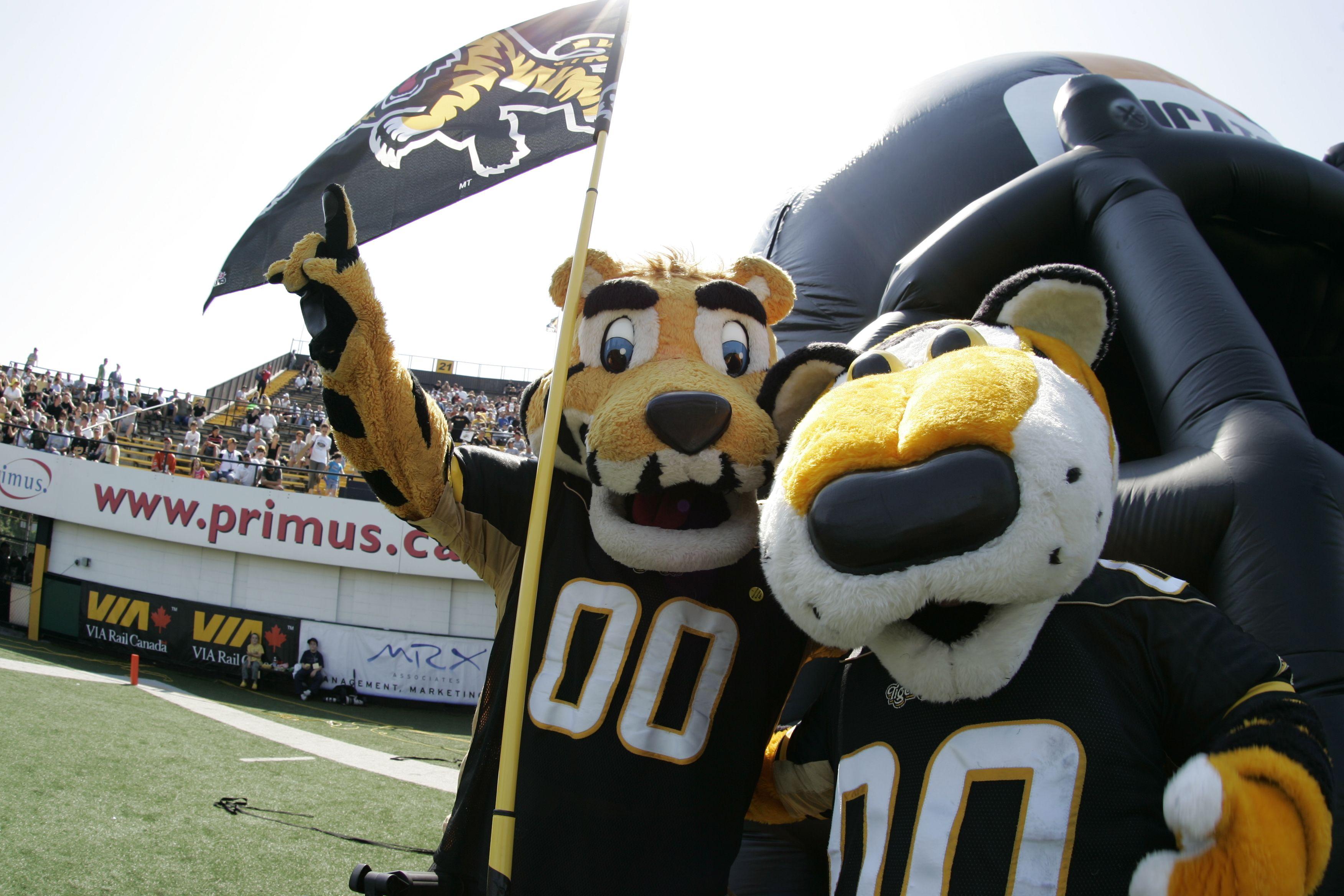 Stripes (left) and TC, Hamilton TigerCats mascots