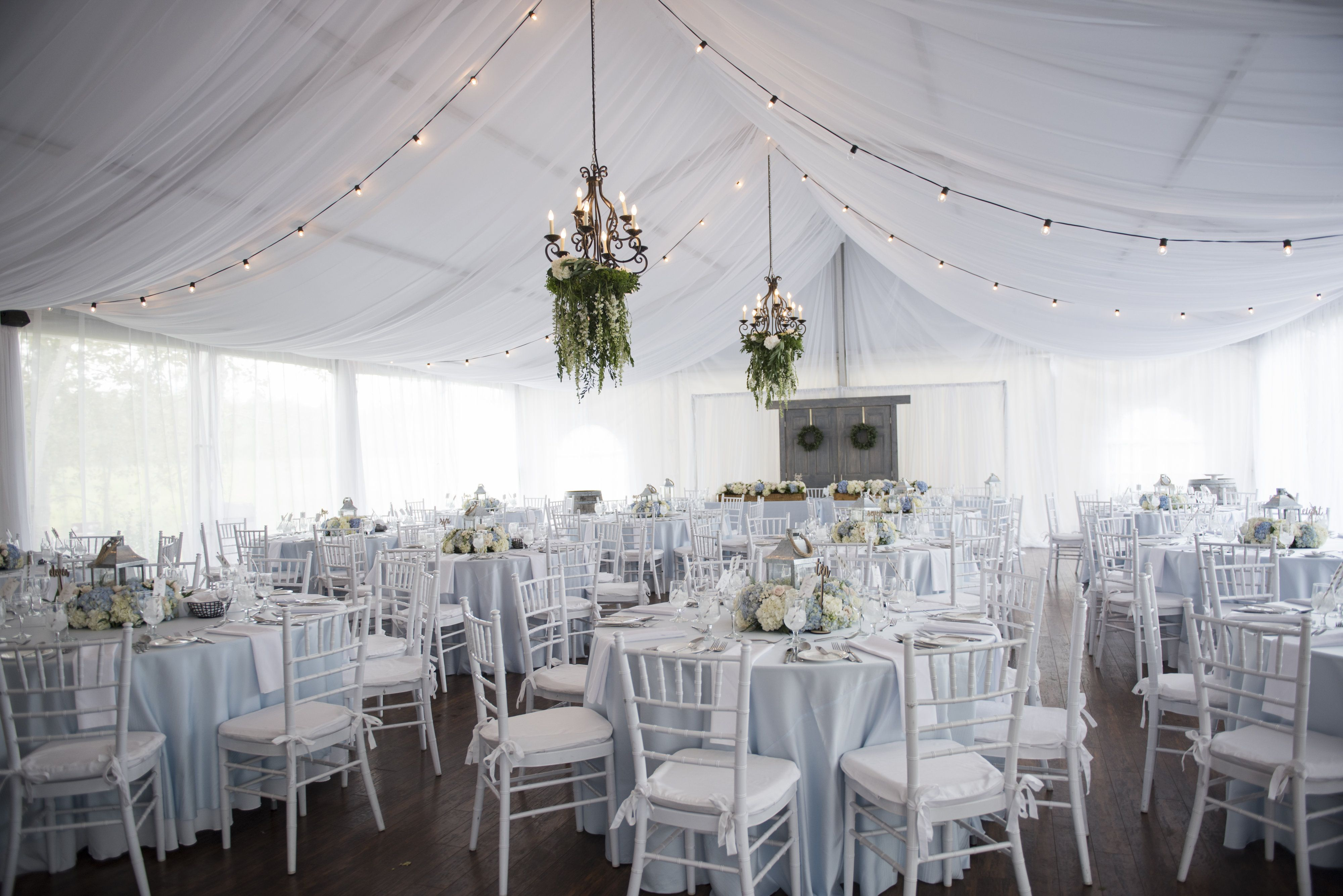 A tented wedding with floral chandeliers in fish creek provincial a tented wedding with floral chandeliers in fish creek provincial park calgary alberta aloadofball Images