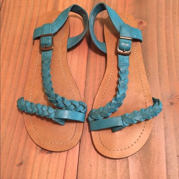 Turquoise flat sandals Flat sandals with a braided toe strap and ankle strap. Bought at target and wore once. Size 6.5 Shoes Sandals