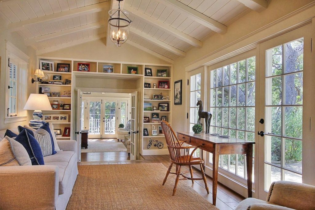 Cottage Living Room With Exposed Beam Built In Bookshelf High Ceiling Hardwood