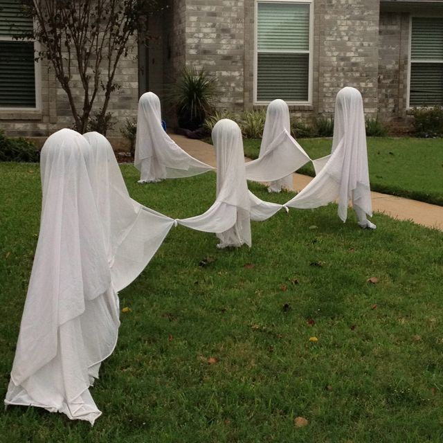 Dancing ghosts made out of bed sheets tied together - Bed made of balls ...