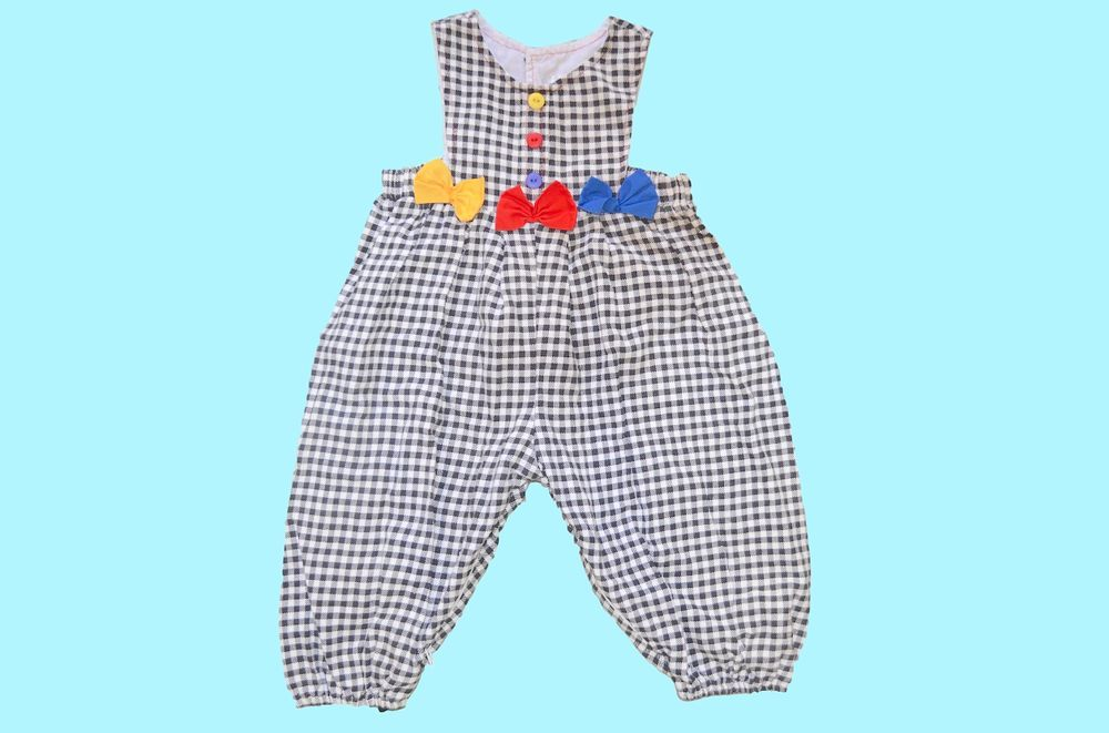 1980s overalls for 1-year-old baby via Childlike Empress Vintage.
