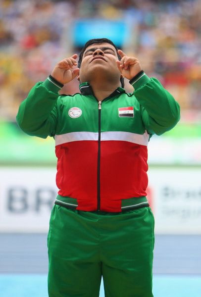 Gold medalist Garrah Tnaiash of Iraq celebrates on the podium at the medal ceremony for the Men's Shot Put - F40 final on day 9 of the Rio 2016 Paralympic Games at the Olympic Stadium on September 16, 2016 in Rio de Janeiro, Brazil.