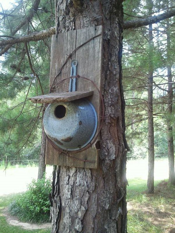bird house made from an old pan, some barn wood and rusty barb wire.