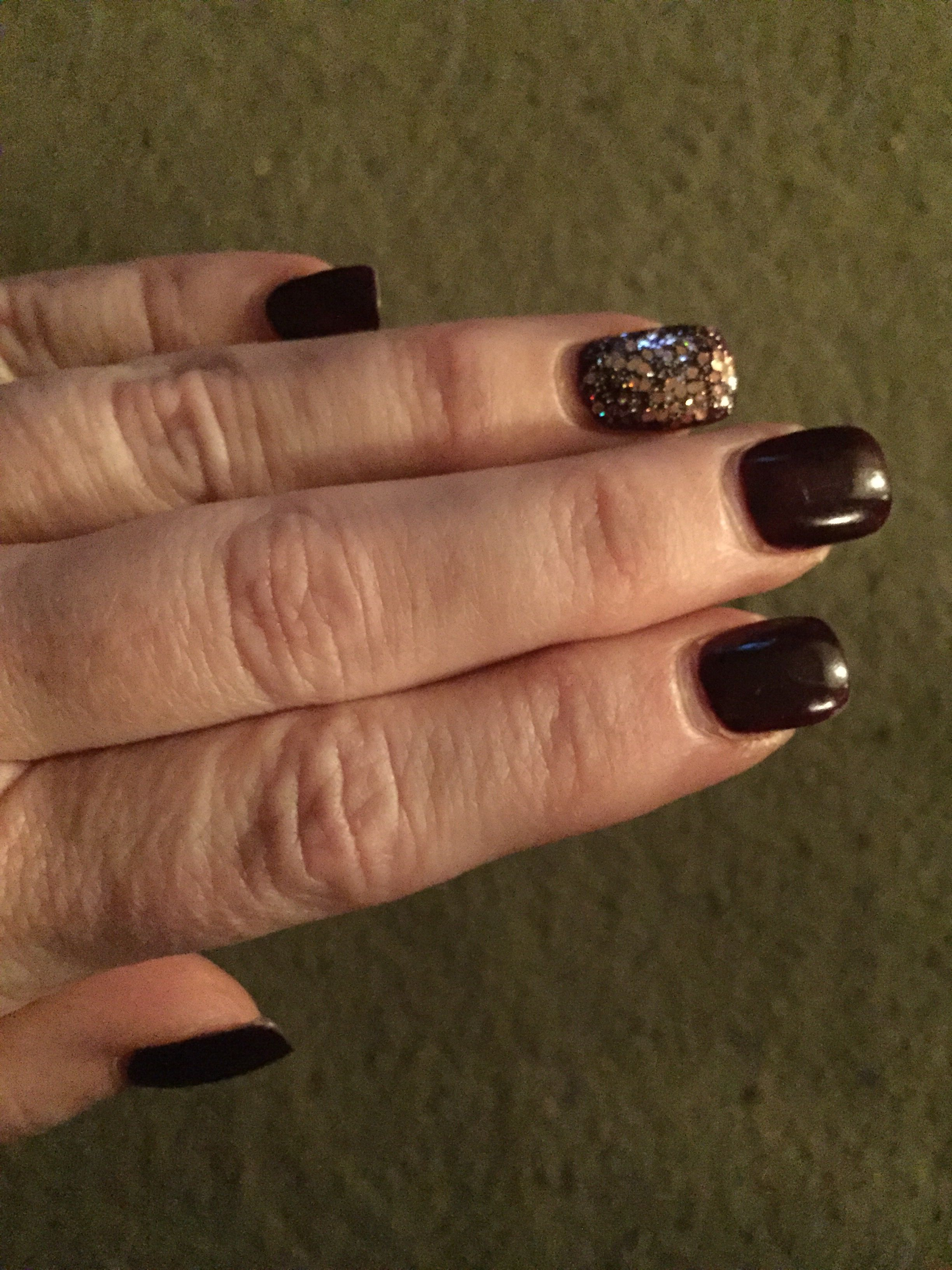 Dark wine nails with a rose gold glitter accent. Done at Paradigm ...