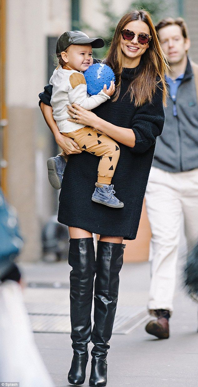 ccc0b0a5d6f ... Miranda ventured out in NYC with her son Flynn on an early-morning  stroll and hid her thin frame under a warm black jumper dress and over-the-knee  boots