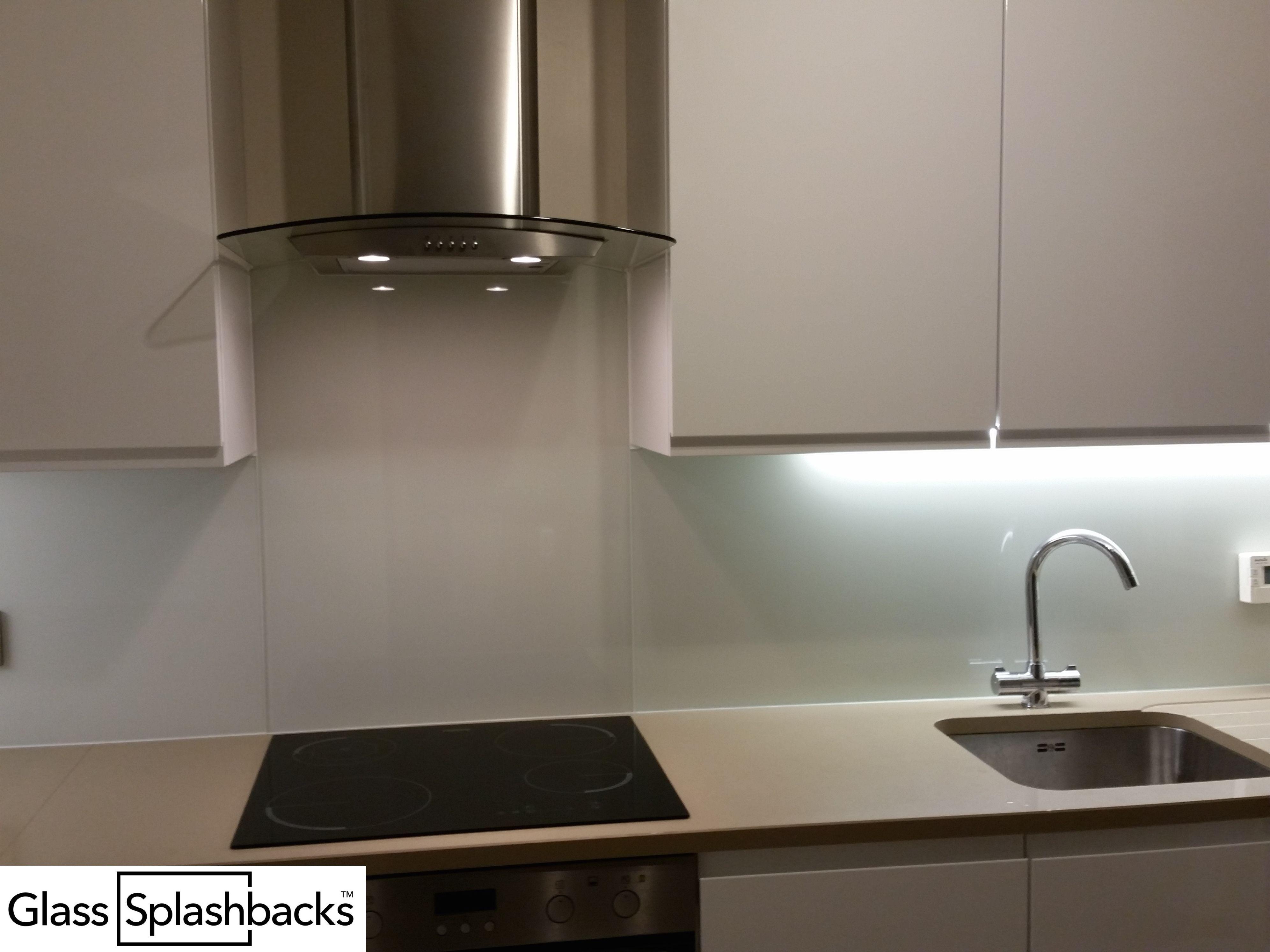 Glass splashbacks for bathroom sinks - Fully Fitted White Glass Splashback Shaped Around Cooker Hood And Plug Sockets Just One