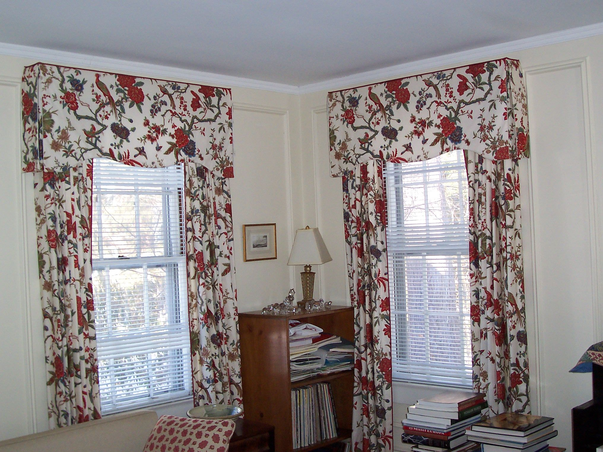 Back tab curtains on traverse rod - Pinch Pleat Drapes Trimmed In Red Band On A Traverse Rod Hidden By Soft Cornice With