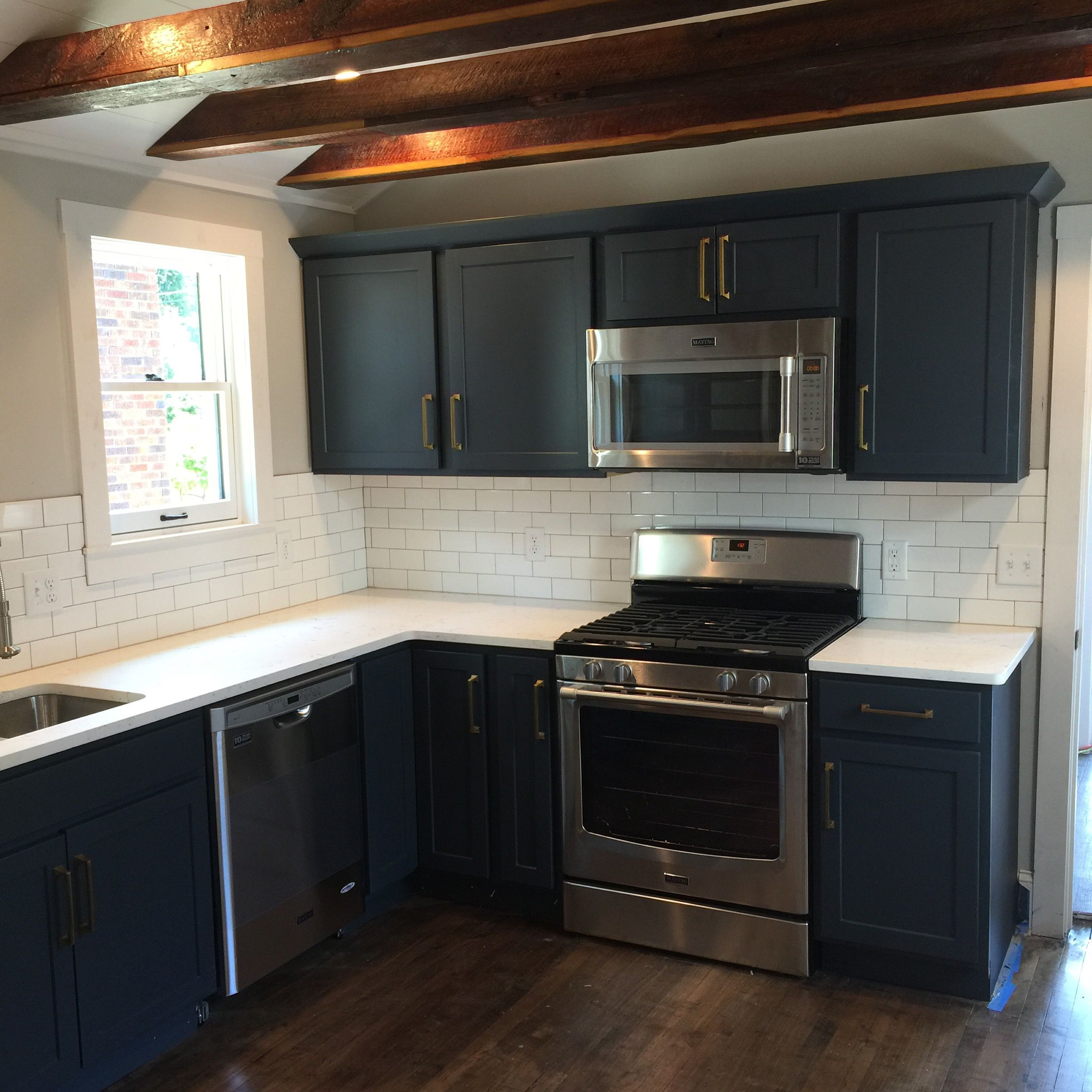 Homecrest Cadet Blue Cabinets Ceiling Joists Wrapped With Reclaimed Lumber Blue Cabinets Homecrest Cabinets Kitchen Inspirations