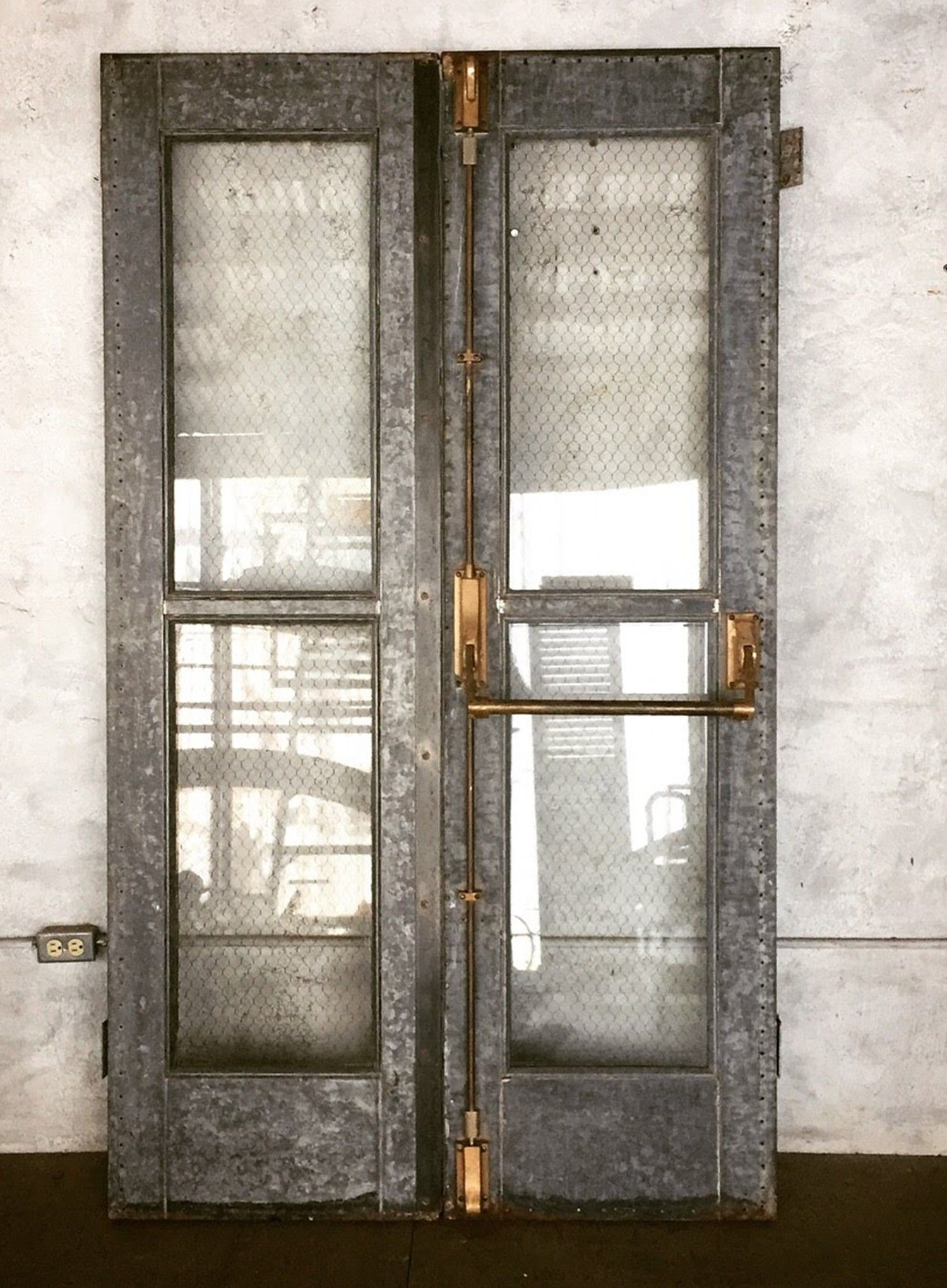 A Stunning Vintage Industrial Door Salvaged From An Old School Building In New Orlea Industrial Interiors Industrial Interior Loft Industrial Decor Living Room