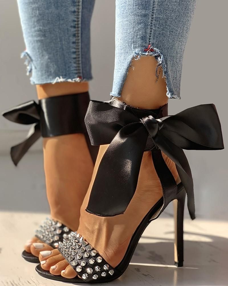 This high heel Sandals will keep your outfit looking ultra-chic throughout the night! Sleek sexy black satin with silver studs, ankle wrap that ties into a large bow, stiletto heels. Synthetic lining with cushioned footbed. Durable man-made sole. 5.0