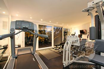 modern exercise room! I would have to add a big screen tv though.