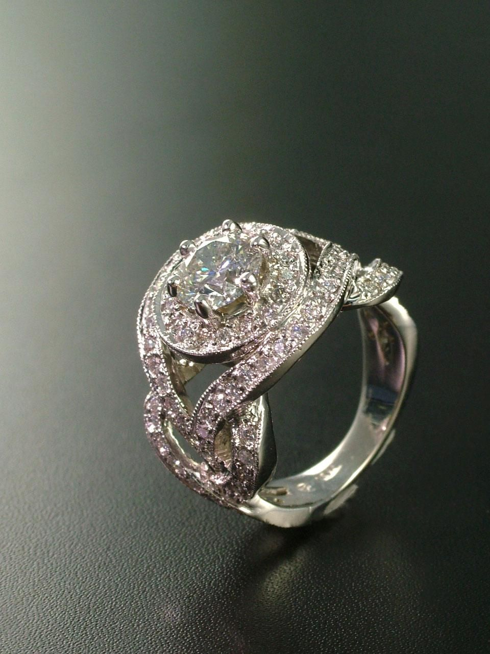 Custom engagement ring with halo and braided band set in white gold