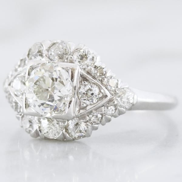 The Lacey ring is an Art Deco ring circa 1930! The ring centers a beautiful old European cut diamond that weighs approximately 0.62 carats of G-H color, VS2 cla