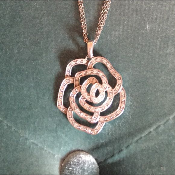 Sterling Silver Flower necklace This all sterling necklace is a beautiful piece. It has a three strand necklace. I bought it at a gem show the quality is nice. Jewelry Necklaces