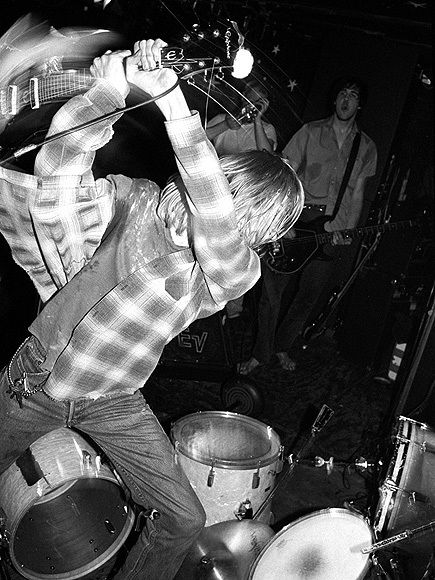 """the sheer epicness of COBAIN about to deliver another massive """"...and not a flying fuck was given"""" onstage guitar smash.. Great form. This stage looks like a par 5. ."""