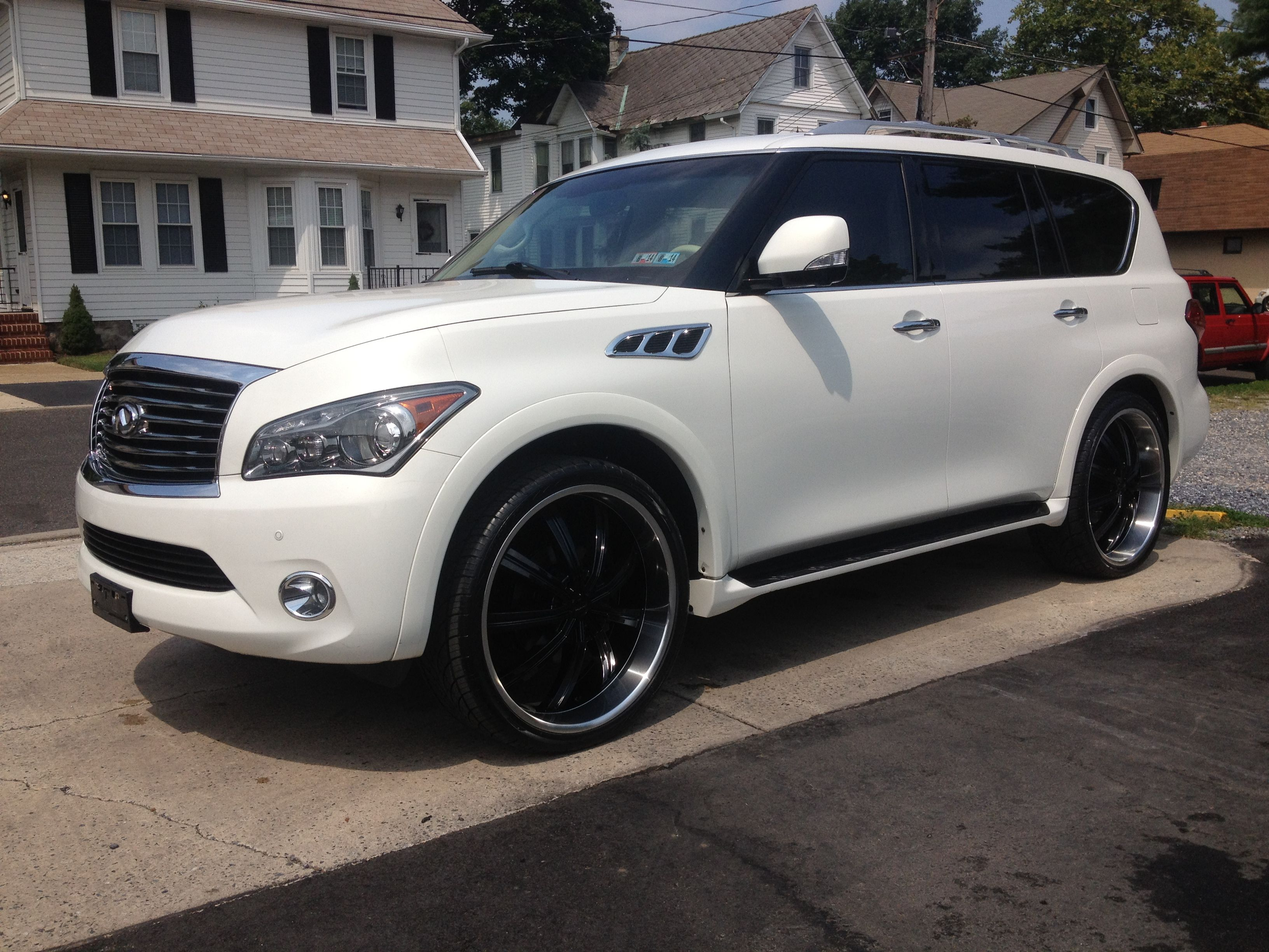 Infiniti qx56 black 2011my family car lol black on black baby qx56 on 26 rims mike vick is no longer broke as evidenced by his vanachro Gallery