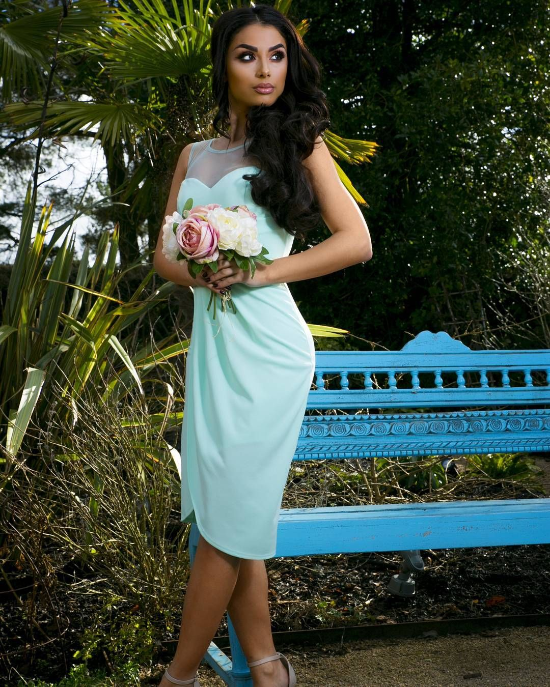 This beautiful mint green midi dress is a perfect option for a short
