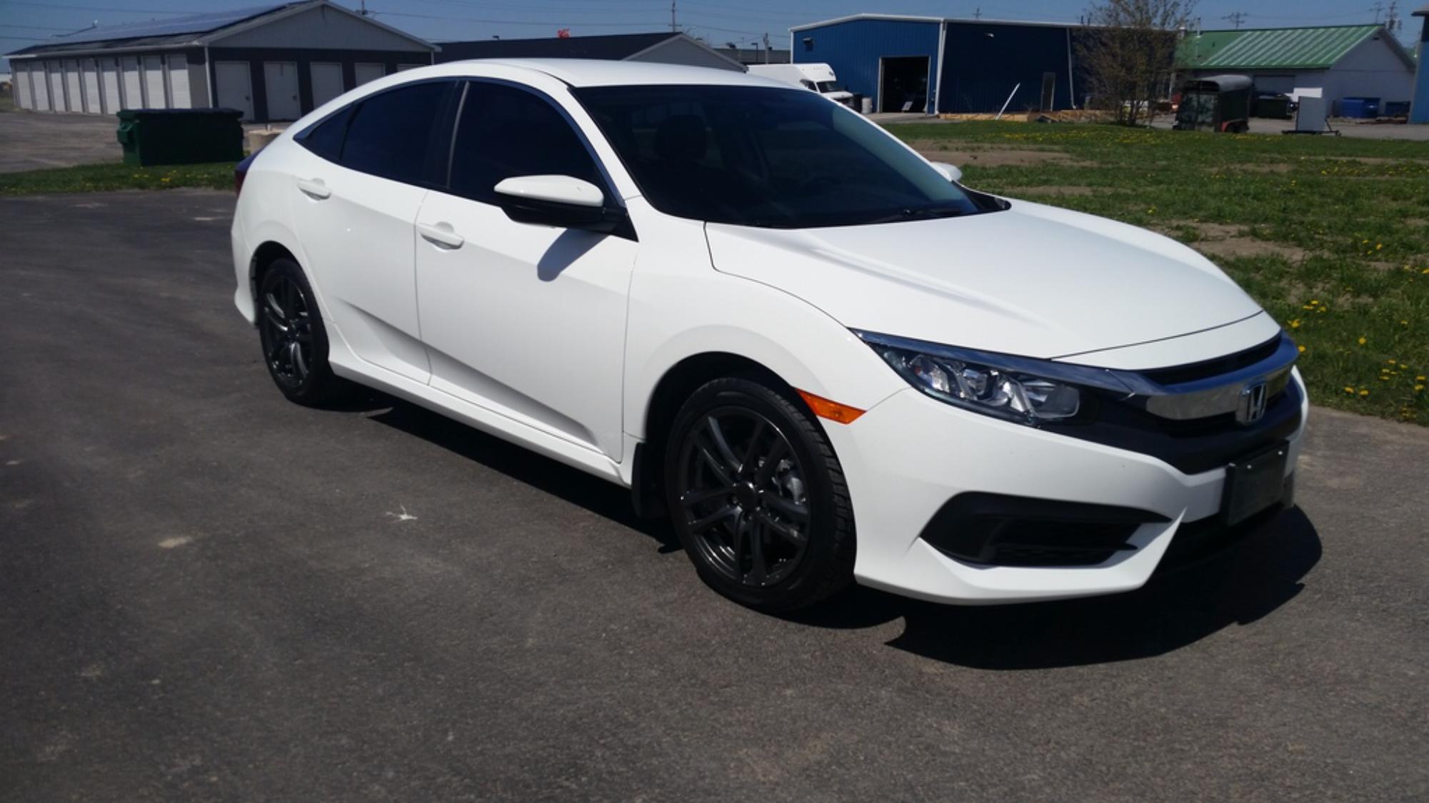 White 2016 Honda Civic With Dark Window Tint And Black Rims
