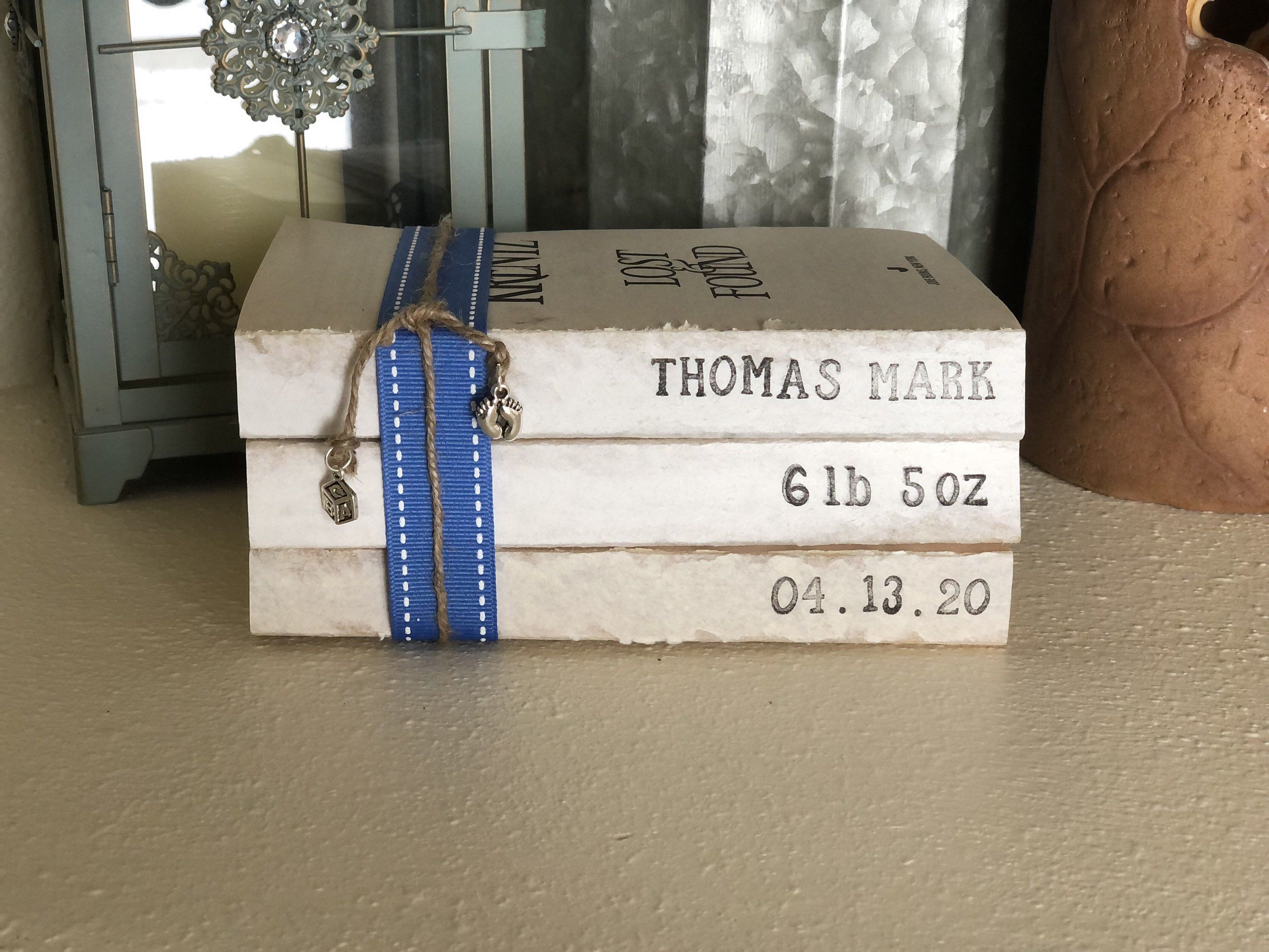 Baby Decorative Stamped Book Bundles Personalized, different ribbon colors and charms adder! $22 #nurserydecorpersonalized #farmhousebabydecor #vintagebarn_nd  #babybookstack