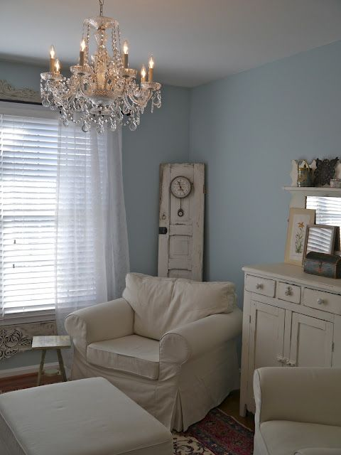 Love the blue walls with the white furniture