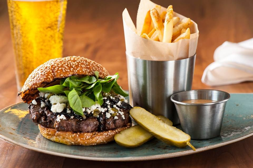 Stonegrill's Bison Burger made with fire roasted poblano, balsamic onions, arugula, chipotle mayonnaise and local feta cheese. JW Marriott Desert Ridge Phoenix Resort & Spa