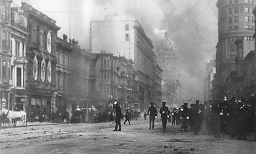 Soldiers patrol the streets while downtown San Francisco burns, 1906.